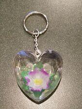 FLOWER FLOATING IN HEART KEYCHAIN