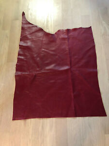New real, red,alkaline dyed through,back is suede, this has branding mark on it.