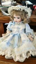 Bisque Girl Jointed Doll in Blue Lace Dress