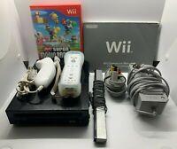 Nintendo Wii Bundle - w/ Remote, Nunchuck, and New Super Mario Bros.