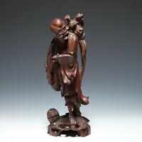 Geschnitzte Figur eines Wanderers - China 20. Jh.