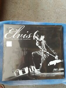 Elvis sun glasses, wood guitar case and pen, playing cards, tin, book and more
