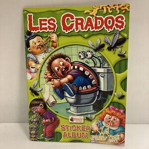 Album type panini Les Crados 3 Merlin Stickers avec 76 autocollants + pochette