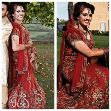 Stunning bridal dress in maroon worn for traditional ceremony for a few hours