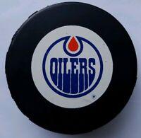 EDMONTON OILERS NHL VINTAGE GENERAL TIRE SLUG TRENCH JOHN A. ZIEGLER GAME PUCK