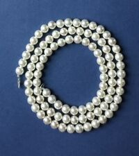 48' luminous faux pearls -10mm with a silver tone lobster claw clasp.