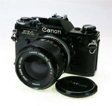 CANON AE-1 BLACK WORKING, 35MM F-2 SSC LENS SOME HAZE, SHIP WORLDWIDE