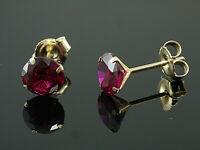585 Gold  Ohrstecker  mit 4 Krappen 1 Paar 6 mm Grösse mit  Rubinen