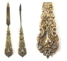 Dos herramientas de vanidad de manicura de plata de ley por Levi & Salaman C