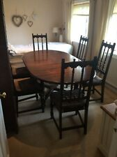 ERCOL OLD COLONIAL SOLID ELM DINING TABLE AND SIX CHAIRS