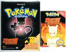 Esa3085. Lot of 2 Pokemon: Art Of First Movie & Mewtwo Strikes Back Scholastic