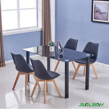 Black tempered glass dining table and 4 Tulip Chairs seats Kitchen