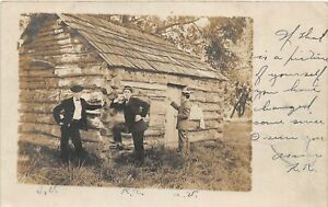 H37/ Rockport Missouri RPPC Postcard 1906 hewn Log Cabin Men