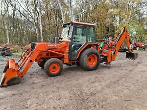 Kubota Compact Tractor L3250 cab, loader and backhoe digger.