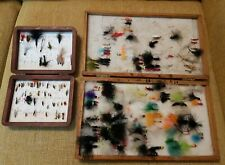 Fly fishing flies in wooden boxes