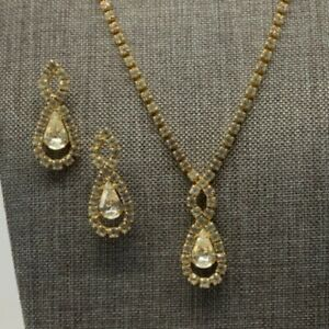 Gold tone clear pear shape rhinestone earring and necklace set