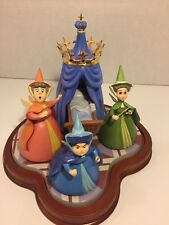 """WDCC Disney Sleeping  Beauty """"An Uninvited Guest"""" Flora, Merryweather, & Fauna."""