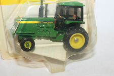Ertl John Deere Tractor, #5571  New on Card,  1/64th Scale