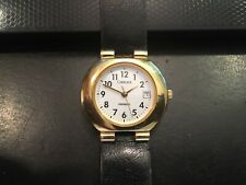 Ladies Gold Tone Carraige Watch with Indiglo and Date