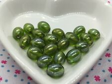 Pack of 20 lime green lustre oval glass beads, 8mm x 6mm