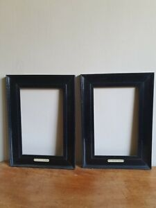 Antique pair of ebonised frames with labels attatched