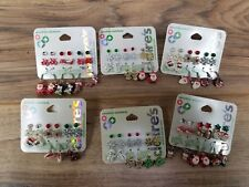 6 packages of Christmas Holidays Claire's Earring sets. Santa Snowman Angel.