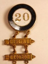 Vintage athletic / sports pin showing enameled 20 with 35 yr and 40 yrd ladders