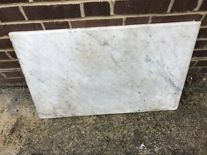 heavy solid marble slab .