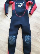 Two bare feet, junior wetsuit, red and black age 10 to 12, 30 inch chest.