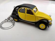 Porte clé 2cv Citroen Charleston jaune et noir neuf en métal