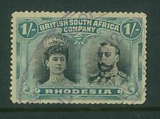 RHODESIA- 1910 1/- Double head (P14) (SG151a) - tidy fiscally used (ES652)