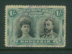 RHODESIA- 1910 1/- Double head (P14) (SG151a) - tidy fiscally used (ES652d)