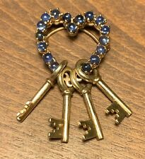 With 17 Cabochon Blue Sapphires (9.6 Grams) 14K Yellow Gold Heart and Key Pin