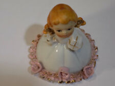 Porcelain Bell Girl Figurine with Gifts and a Dress with Roses