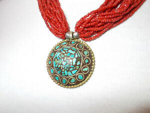 Vintage Tibetan pendant necklace Inlaid turquoise chips and red glass beads