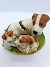 Jack Russell Terrier Mom And 3 Pups In A Basket