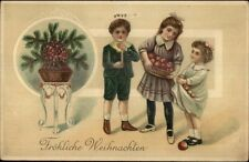 German Christmas Children w/ Basket of Fruit c1910 Embossed Postcard