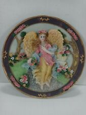 3D Angel picking up flowers from a garden. porcelain Plate