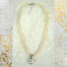 ConMiGo  five find strings of small pearls with a big silver sparkling pearl dro