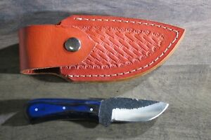 Small High Carbon hunting knife w/ blue laminate stocks & leather sheath