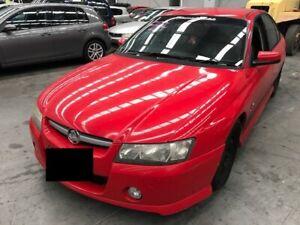 2004 Red Holden Commodore Sedan
