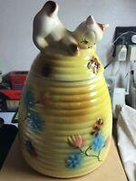 Cat on beehive cookie jar