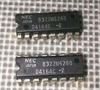 2x - NEC D4164C-2 64Kx1 8KB 200ns 16-pin DIP DRAM chip.