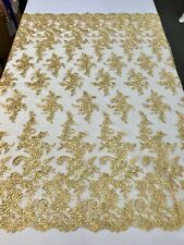 METALLIC GOLD FLORAL DESIGN EMBROIDER WITH SEQUINS-CORDED LACE-SOLD BY THE YARD.