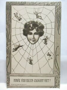 1910 POSTCARD HAVE YOU BEEN CAUGHT YET? LADY CATCHING MEN FLIES IN SPIDER WEB