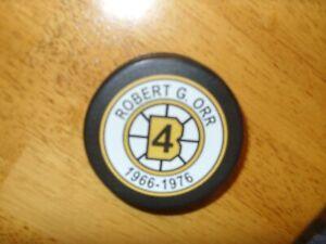 (RARE)    BOSTON BRUINS  ##4 BOBBY ORR  RETIREMENT PUCK 1966/1976