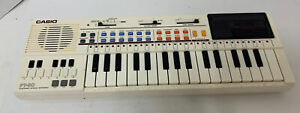 Casio PT-80 Mini Electronic Piano Keyboard with World Songs ROM Pack WORKS GREAT