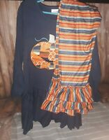 size 8/9 girls boutique outfit. Navy blue and orange striped pants. Cute pumpkin