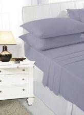 Draps-housses gris pour le lit