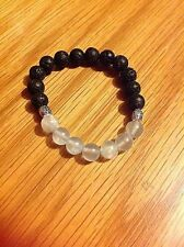 AQUAMARINE GEMSTONE AND LAVA HEALING  BRACELET. MADE WITH LOVE IN THE UK.